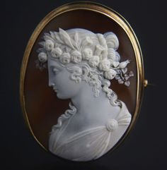 Victorian cameo brooch depicting the goddess Flora in 14K gold mount (US $2,000)