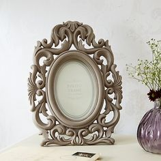 This beautiful photo frame is for you if you adore rustic romance shabby chic. Painted cream and made of pewter this lovely frame has an aged look with rust effect on its edges. The style is a little Art Deco with pretty fretwork , garlands and flowers. We think this would make a lovely gift with a photograph of a loved one or just simply treat yourself! This frame should be selling for around twenty pounds but our supplier has reduced it and we are passing the saving on to you. Photograph…