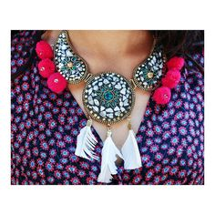 Know about our  D R E A M  O N  N E C K P I E C E  Exquisite tibetian art of lac work that is handcrafted by our female artisans in india.  Lac white feather and fucsia pom pom are used to complete the neckpiece. Gold details and the base is brass metal.  To place an order and other queries mail us at whimsicalwheeel@gmail.com or DM us on instagram / facebook.  #whimsicalwheeel #withloveforyou #bohotales #brassandbaubles #tibetianwork #pompom #fashionandlifestylebrand #whimsygypsy #bevibrant…