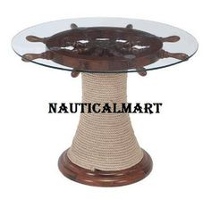 Nauticalbase 30 Ship Whell Table With Natural Oak Wood For Home Decor,  BEAUTIFUL & DECORATIVE SHIP WHEEL TABLE MADE OF GOOD QUALITY OAK WOOD, GLASS & ROPE SIZE OF THE SHIP WHEEL: 30 INCHES & HEIGHT OF THE TABLE: 18 INCHES ROPED WOODEN BASE GREAT NAUTICAL COLLECTION FOR LOVERS