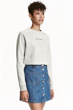 Sweatshirt with motif: Top in soft sweatshirt fabric with a motif on the front and ribbing around the neckline, cuffs and hem. Soft brushed inside.