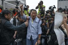 Tycoon and Apple Daily Newspaper owner Jimmy Lai shouts slogan before he is taken away by police officer at an area previously blocked by pro-democracy supporters, outside the government headquarters in Hong Kong, December 11, 2014. REUTERS/Athit Perawongmetha