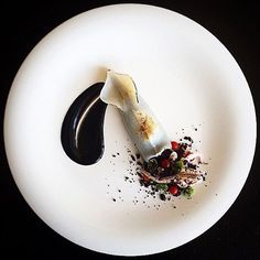 [Throwback Sunday] Check out this stunning piece of art by @tadashi_takayama Squid stuffed black rice, black olive and garlic cream with ink. #GourmetArtistry Tag a friend who'd love this