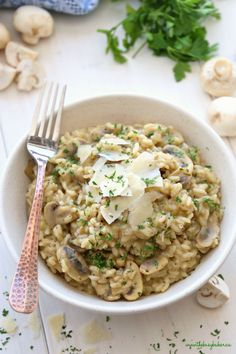 This Easy Mushroom Risotto is a quick and simple way to make restaurant-style risotto at home in minutes and in only one pan! Skip the fancy restaurant and enjoy it at home as a vegetarian main dish or side dish! Recipe from thebusybaker.ca! #easyrisotto #simplerisottorecipe #mushroomrisotto
