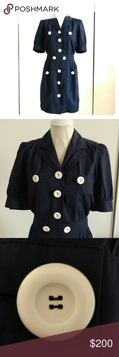 Louis Vuitton Vintage Navy Dress Great Condition, no rips, stains, stairs or press marks.  Bought at a high end consignment shop 4 years ago and wore once.  It's from winter 04.  Been stored in a garment bag in the back of my closet.  Size 36 but fits more like a 4.  This is NOT Louis Vuitton Uniformes, even though it looks like a uniform.  Buttons say Louis Vuitton.  All are original and have never been sewn back on. Louis Vuitton Dresses Midi