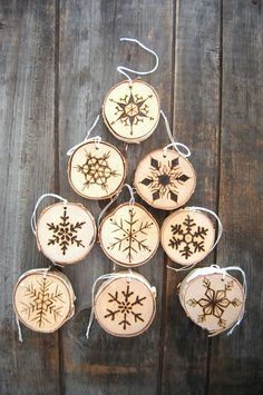Wood burned Christmas tree ornaments snowflakes holiday Christmas ornament snowflake rustic birch wood by REEckerson on Etsy https://www.etsy.com/listing/212134174/wood-burned-christmas-tree-ornaments
