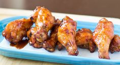 Oven Baked Coca Cola Chicken Wings are fun and easy for your next party! Bake chicken wings until crispy, then douse in a sweet and spicy homemade Coca Cola sauce.