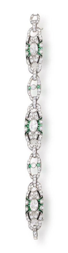 An art deco diamond, emerald and onyx bracelet, circa 1925  designed as three oval-shaped panels each centering an old marquise-shaped diamond within an openwork surround of round brilliant-cut diamonds, calibré-cut emeralds and (later) onyx, each with smaller diamond and emerald openwork spacers; marquise diamonds each approximately: 1.00 carat; remaining diamonds weighing approximately: 4.75 carats total; mounted in platinum; length: 6 5/8in. (several small stones deficient)