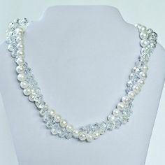 Crystals or pearls? It is such a hard choice. Why not choose both? If you are looking for a fabulous multistrand necklace, this Crystal and Pearl Twist Necklace combines two favorite bead types into one stellar look.