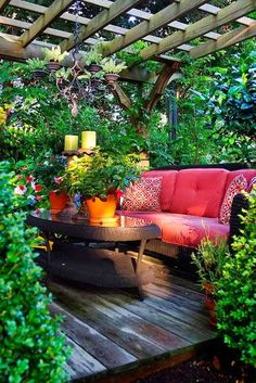 Via LINDSEY CAINE @lindseycaine Pic: Secluded lush patio under pergola with red seating. From the meet this community board