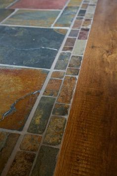 Image result for stone entryway transition to wood floor