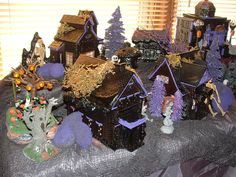 the black houses and buildings with purple trim and festive  items for Spookyness