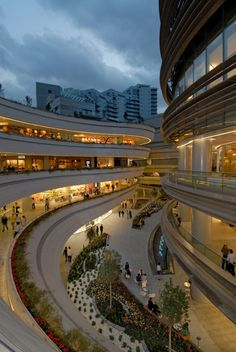 Kanyon, the amazing shopping centre in Istanbul (at Levent district), this could work for Garden Place, but it becomes more of a concrete jungle than a garden place.....