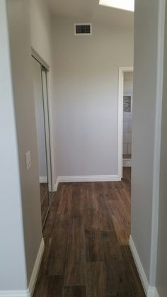 Walnut plank tile floors with clean slate wall paint.