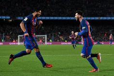 Lionel Messi of FC Barcelona celebrates with his team mate Luis Suarez after scoring his team's fourth goal during the La Liga match between FC Barcelona and RCD Espanyol at the Camp Nou stadium on December 18, 2016 in Barcelona, Catalonia.