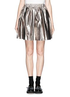 High shine and high impact, this metallic mini skirt from MSGM is a statement piece which can be effortlessly dressed up or down. Worn here with a cosy knit sweater for an on trend texture clash, this skirt is wearable whilst maintaining that quirky edge.