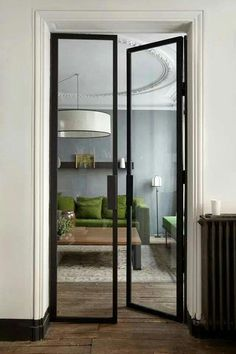 A green sofa for a gray apartment Un canapé vert pour un appartement gris Green Sofa, Steel Doors, Windows And Doors, Home And Living, Living Room, Apartment Living, Interior Architecture, House Design, Home Decor