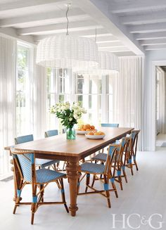 The breakfast room features light fixtures and a walnut table from Gervasoni; the bistro chairs are from TK Collections. B Five Studio's Franklin Salasky gives modern polish to a classic structure.