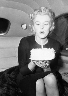 MARILYN MONROE, making a wish and blowing out the candle on her birthday cake.       #June #Birthdays #MarilynMonroe