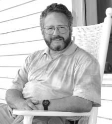 At right: Dr. Robert Spitzer, a clinical neurologist from Mackinac Island and Southfield, enjoys the porch at Grand Hotel and a break from his busy schedule. Through his research, he has made a link among fibromyalgia, chronic fatigue, and narcolepsy. Now he is writing a paper on the muscular aspects of fibromyalgia and chronic fatigue.