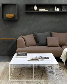 Playing a central role in a living space, coffee table can bring not only a practical but also an artistic value to your home interior. Whether it's a particular style you are looking for or a unique solution to make a bold statement, our ultimate guide will make it easy to pick a perfect coffee table for your taste. Explore our tips and ideas as well as a selection of artisanal coffee tables, handpicked and sorted by shape, style and material for your convenience. Minimalist Living, Minimalist Decor, Minimalist Design, Living Room Accents, Living Room Sofa, Coffee Table Vignettes, Coffee Tables, Long Sofa, Mid Century Modern Living Room