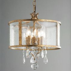 "A modern drum shade concept takes a turn towards vintage elegance with crystal pendalogues, antiqued frame, and ripple glass. Hang it down in high ceiling foyers or use one chain link to hang as a semi flush ceiling light. Select Antique Silver or Aged Gold Leaf. 4x60 watts candle sockets. (16.5""Hx15""W) Supplied with 10' of chain chain and 15' of cord."