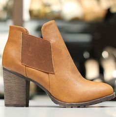 """These side-elastic ankle boots are absolutely gorgeous. They are standard style with a 3.25"""" chunky heel. They come in black, brown, and chestnut color. Faux-leather material.These have been running true to size!"""
