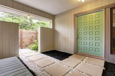 Mint door.  Yucca Plant was a Martha Stewart color I can't seem to find anywhere. Concrete block walkway. Rubber mulch. Modern.