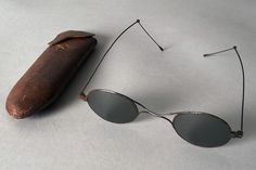Tinted eyeglasses with leather case, American, 19th century, KSUM 2000.21.9 ab.