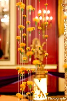 The custom mandap is draped with yellow floral garland for the Indian Hindu wedding ceremony. Wedding decor ideas
