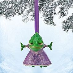 Disney Pascal Sketchbook Ornament - Tangled | Disney StorePascal Sketchbook Ornament - Tangled - A chameleon loves to disguise himself, so little Pascal is elegantly costumed as his best friend Rapunzel for this fun and festive ornament that will be a highlight of your holiday home trims, especially with the kids!