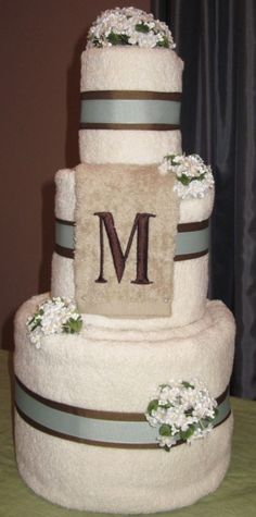 Wedding Towel Cake. Gift for a bridal shower. Personalized with monogram and color scheme. this page has great ideas