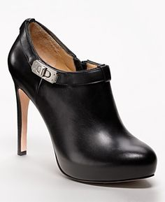 black booties...hmmm...these or the fab heels...