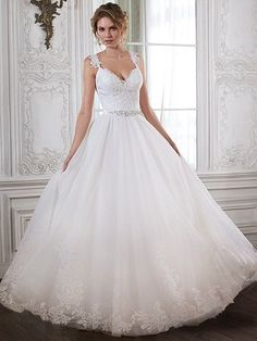 Maggie Sottero - CRYSTAL, Beautifully detailed with lace and a dazzling Swarovski crystal belt, the fitted bodice of this ball gown cascades into a romantic tulle skirt. Complete with V-neckline and cap sleeves. Finished with crystal button over zipper back closure.