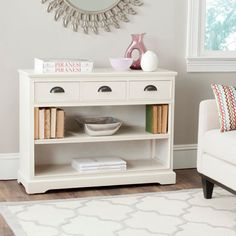 Form meets function in the vintage-look Prudence bookshelf unit in pine with a shabby-chic white painted finish.