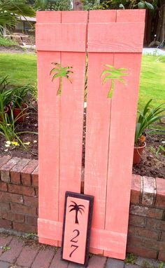 Coral palm tree shutters by CastawaysHall on Etsy.