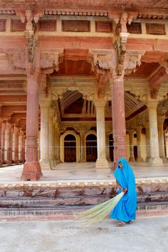 Ralph Belasco took this image at the Amber Palace, in Amber, India, just outside of Jaipur, which is also know as the Pink City. This woman was one of several sweeping the palace dressed in bright blue sarees.