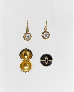 Diamond earrings with snap-on covers for Mourning c1882-85. Gold, diamond, and enamel. (via The Met)