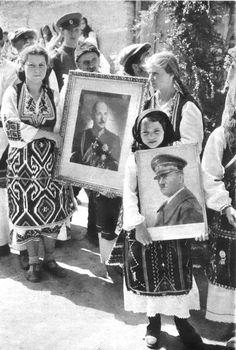 Young Bulgarian girls carry portraits of Bulgarian Tsar Boris III and Adolf Hitler, 1941