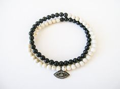bracelet // double wrap black onyx and natural fossil stones, and pave diamond evil eye charm