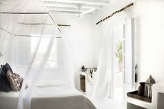 Wooden curtain rods- Love the play of textures.