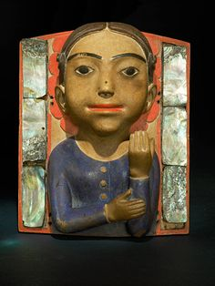 Very unusual haida frontlet depicting a woman. 19th century.