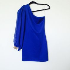 Royal Blue one sleeve dress Size small royal blue dress with one sheer sleeve and gold embellished wrist! Dresses