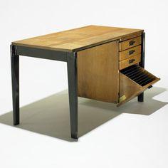 Lot 256: Jean Prouvé. Dactylo desk no. BD 41. 1941 / c. 1947, enameled steel, oak. 28 w x 47 d x 23½ h in. result: $9,600. estimate: $10,000–15,000.