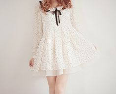 This layered white dress with the white peter pan collar and black ribbon would look perfect for a day date.