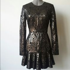 Metallic Floral Lace Dress |RE-POSH| Metallic Floral Lace Overlay Detailed Dress with back zipper closure.  The dress tag reads as a size 6, however, I would say this dress will best fit a size 4. This dress was purchased here on poshmark. DKNY Dresses Mini