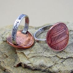 PENNY FOR YOUR THOUGHTS has been stamped onto a sterling silver ring band and soldered a copper US penny securely to the band. The penny has a