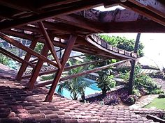 Moon Dust Residence, Madh Island: Exterior detail of the terracotta-tiled roof overhang supported by numerous struts | Archnet