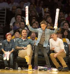 With his brothers Cruz (far left) and Brooklyn (far right) and dad David looking on, Romeo Beckham, 10, boogied at the Nov. 18 L.A. Lakers game at the Staples Center.