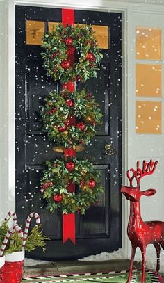 make your first impression extra jolly with the professionally decorated look of three wreaths on a red velveteen ribbon - Pinterest Christmas